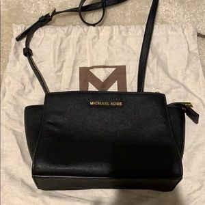 Black Michael Kors crossbody with adjustable strap